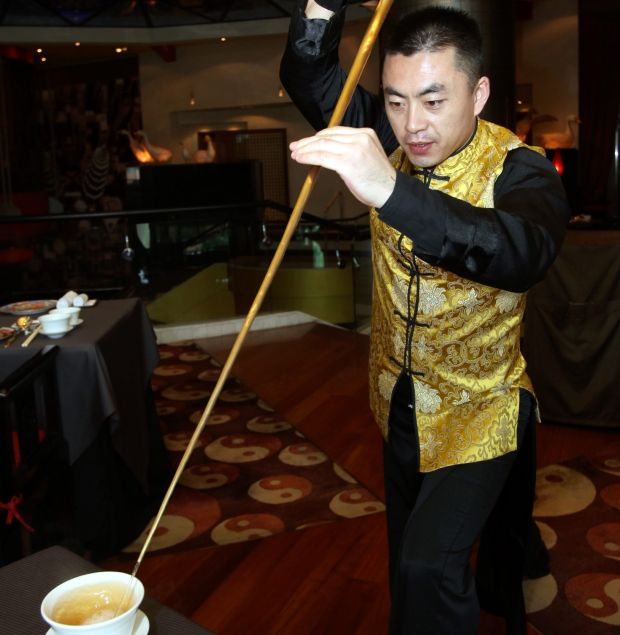 Those dining at Hilton Kuala Lumpur's Chynna restaurant will be able to watch their tea master in action, serving up a cup of fragrant welcome tea. AHMAD IZZRAFIQ ALIAS / The Star.