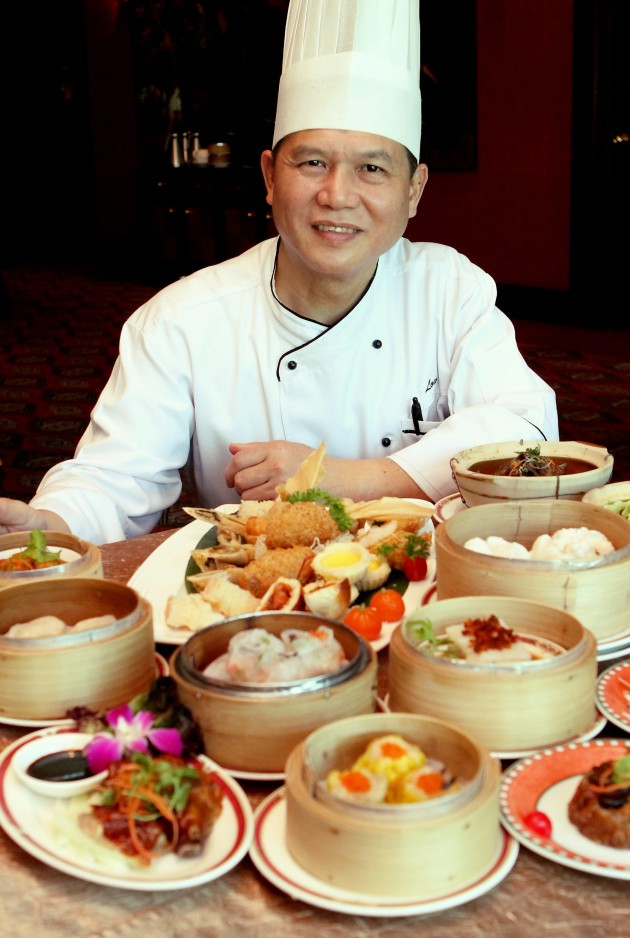 Dim Sum chef Low Kim Ong with his array of dim sum favourites served at the restaurant.