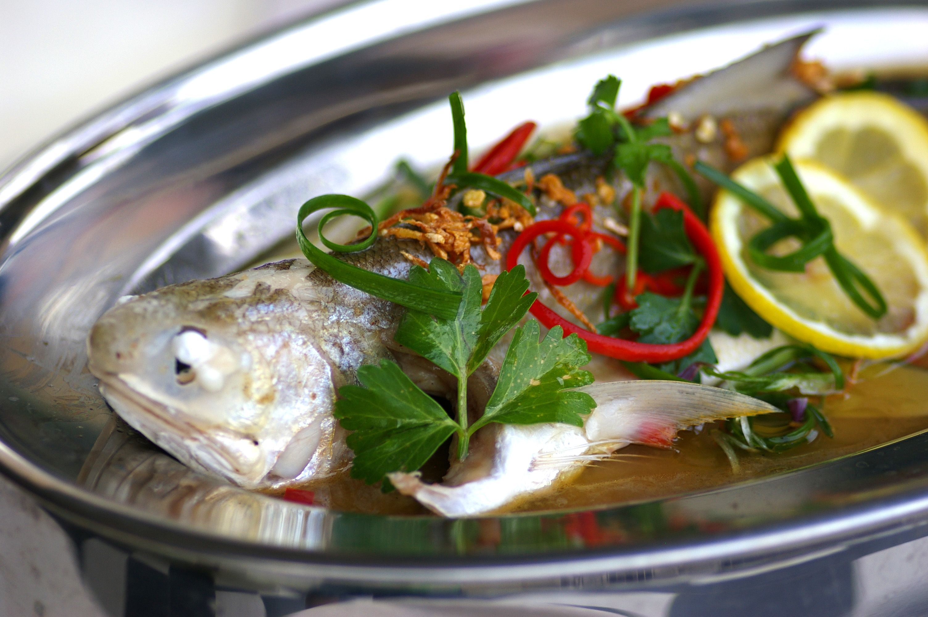 Steamed fish in tangy lemon sauce kuali for Asian fish sauce