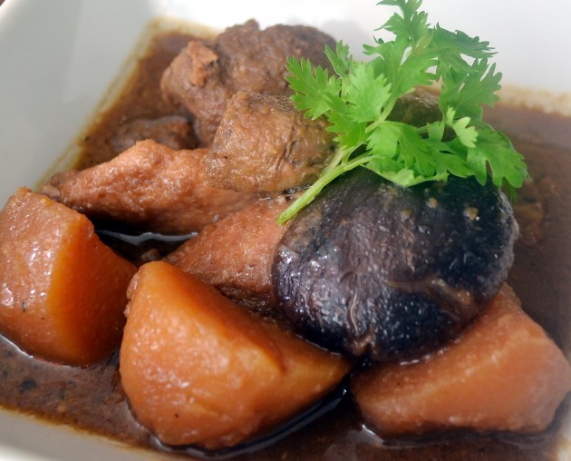 Ayam Pongteh: Traditional Nyonya stew with chicken, potatoes, and soy bean paste gravy.