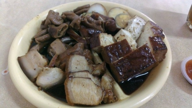 Braised pork belly, tofu, egg and pig's entrails.