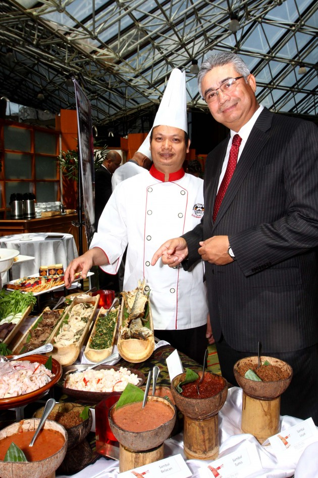 Mohmad Halim (right) and Sany, from Sarawak, show off the sumptuous spread for the Sarawak Food and Cultural Festival 2014 at Seri Pacific Hotel Kuala Lumpur.