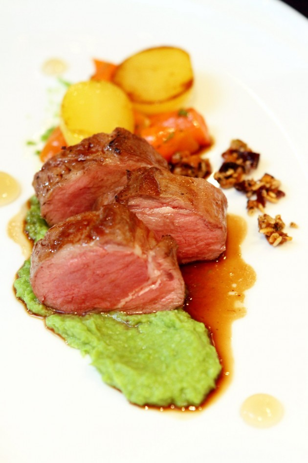 Pan Seared Loin of Lamb with sous vide potatoes, vichy carrots, mint jelly and pan sauce.