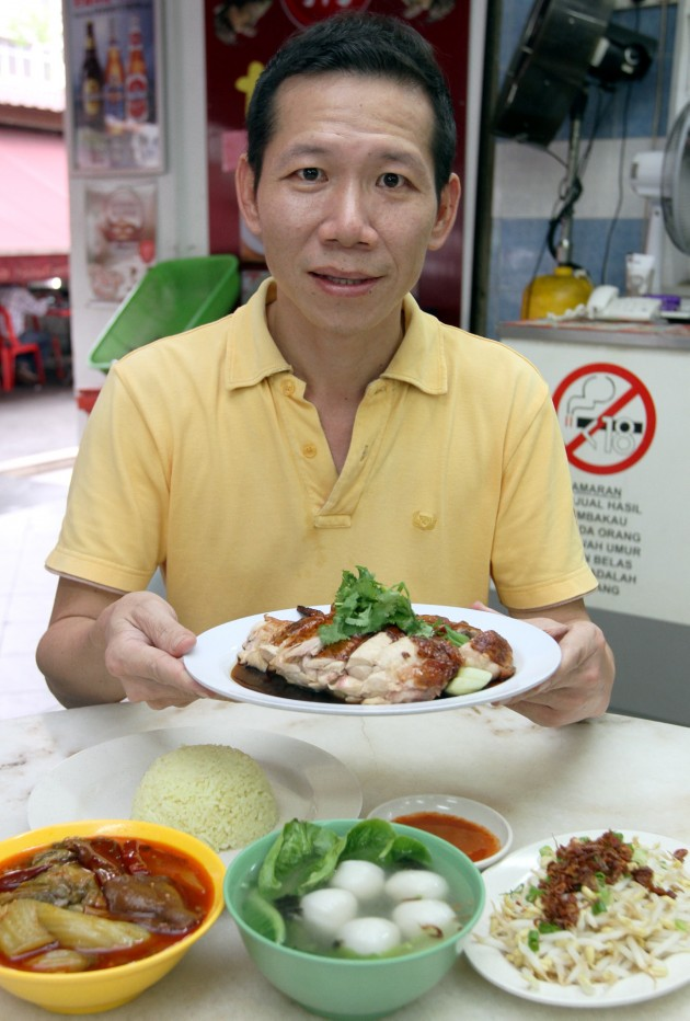 Danny Koh with his famous Tim Kee chicken rice. The chicken is roasted the traditional way in a charcoal oven.