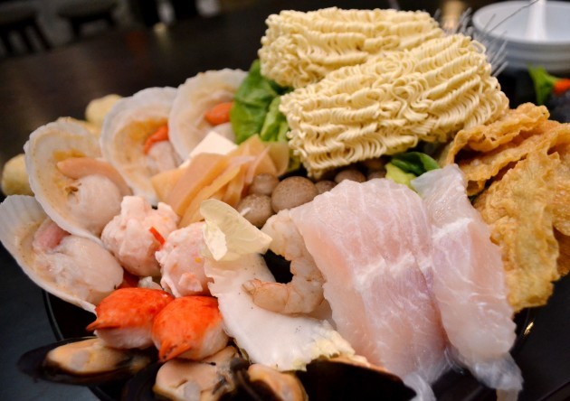 The set consist of fresh seafood such as half-shell scallops, green mussels, dory fish fillets, brown squids, crab claws, lobster balls, prawns, and others.