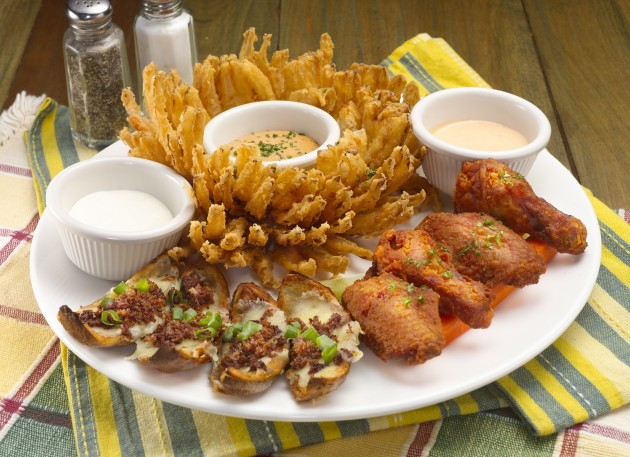 Awesome Threesome, featuring Morganfield's most famous appetisers: Onion Blossom, Spicy Chicken Wings and Russet Potato Skins.