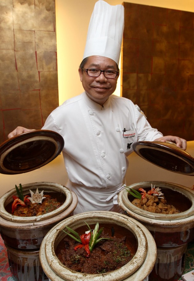 Chef Zaffar showing the delightful Malay dishes that will be served at JW Marriott Kuala Lumpur during Ramadan.