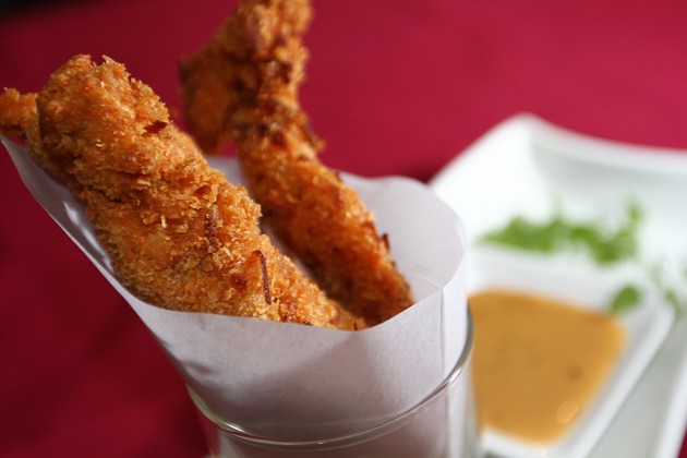 Coconut chicken strips with honey soya dipping sauce.