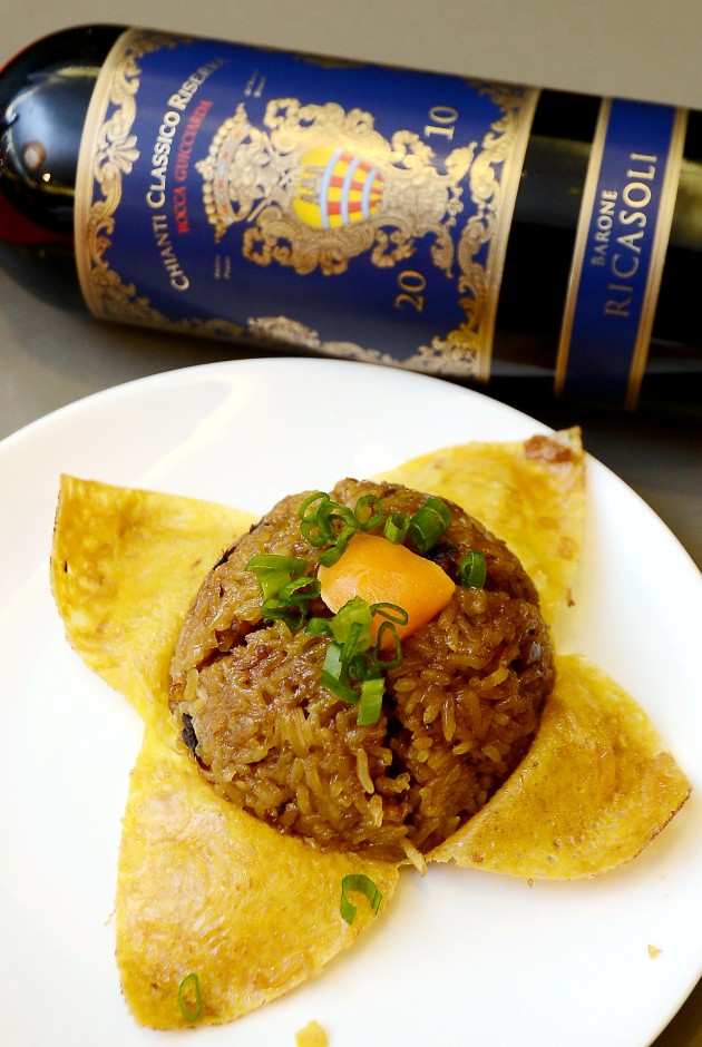 Glutinous rice with salted egg yolk is best paired with red wine Barone Ricasoli Rocca Guicciarda Chianti year 2010 from Italy.