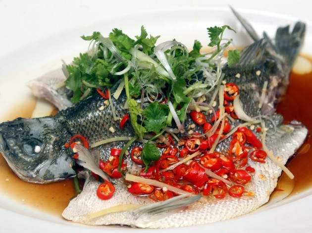 The Jade Perch fish is steamed and sprinkled with cili padi.