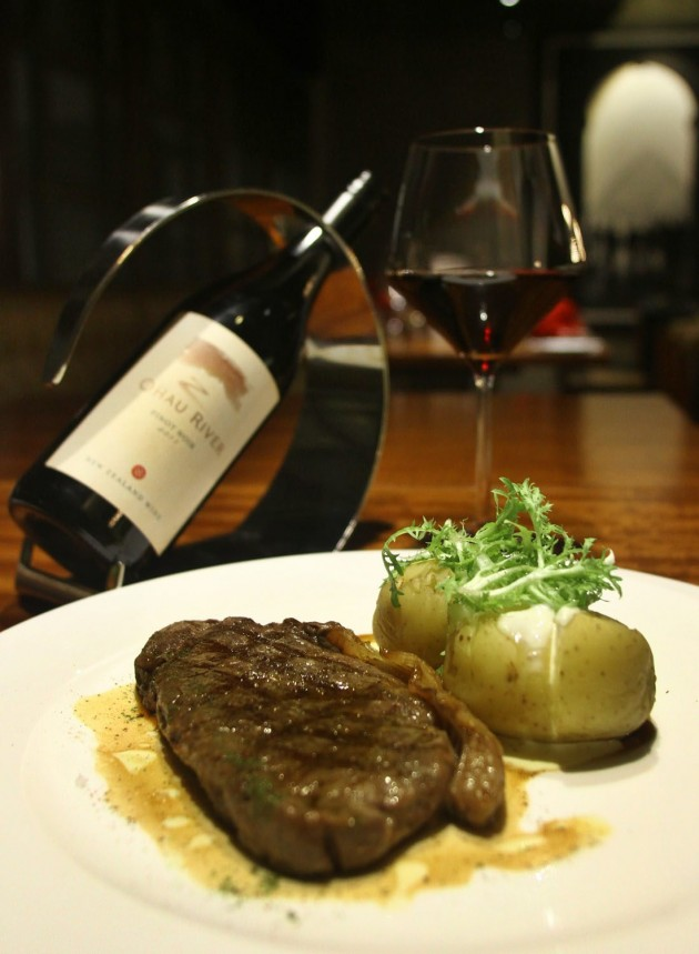 The Grilled Black Angus Sirloin with Baked Potato and Sour Cream is paired with Pinot Noir, 2009 from New Zealand.