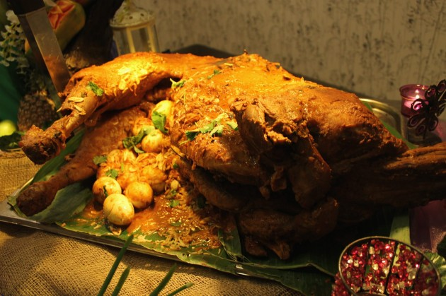 The aromatic Lamb Kuzi is cooked with rich herbs and spices and served with beriani rice.
