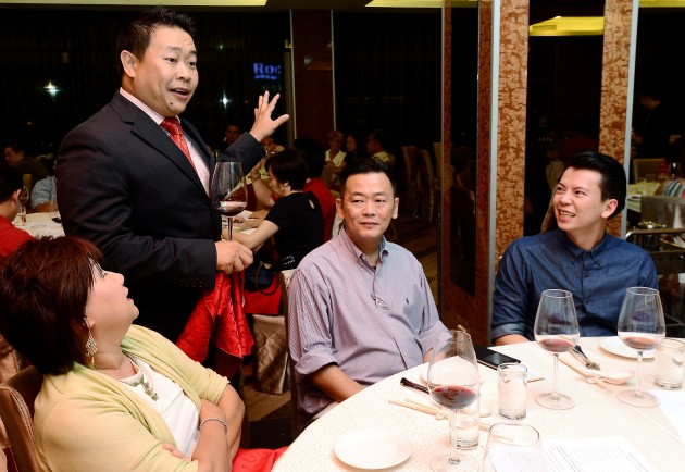 Wine expert Jonathan Cheah (standing) briefing guests on the dos and don'ts of pairing Chinese food with wine at Overseas Restaurant.