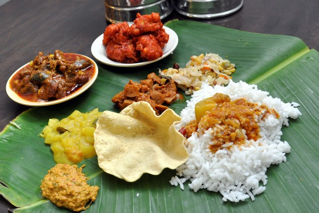 A banana leaf rice meal with mutton costs RM11, while a rice set with fish or chicken is priced at RM10 at Archana Curry House.