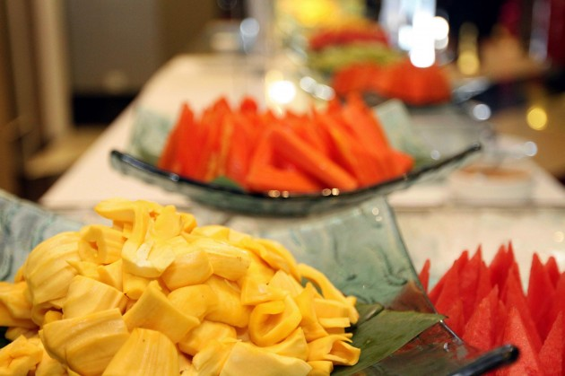 A selection of local fruits are available at the buffet spread.