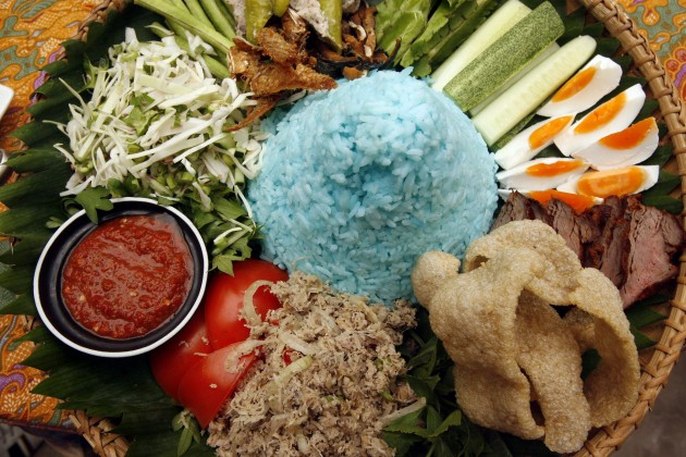 Appetising Nasi Kerabu served with fried salted fish, fish crackers, slivers of salted egg, fresh vegetables, budu and coconut sambal.