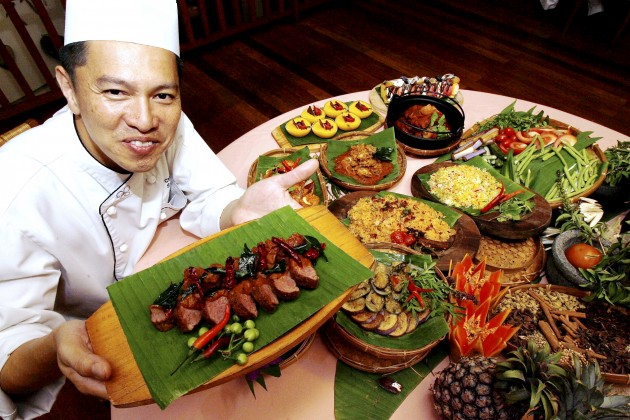 Avillion Port Dickson executive chef Chan with the fusion dishes he concocted for the hotel's buka puasa buffet.