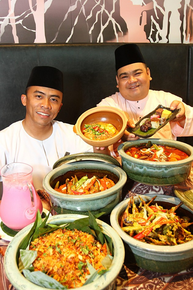 Chef Hashrul (left) and chef Farez showing off some of the sumptuous finds on buffet line at Vasco's this Ramadan.