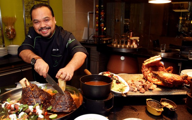 Chef Zubir Md Zain carves the day's special at Latest Recipe, Beef Minced Shank.