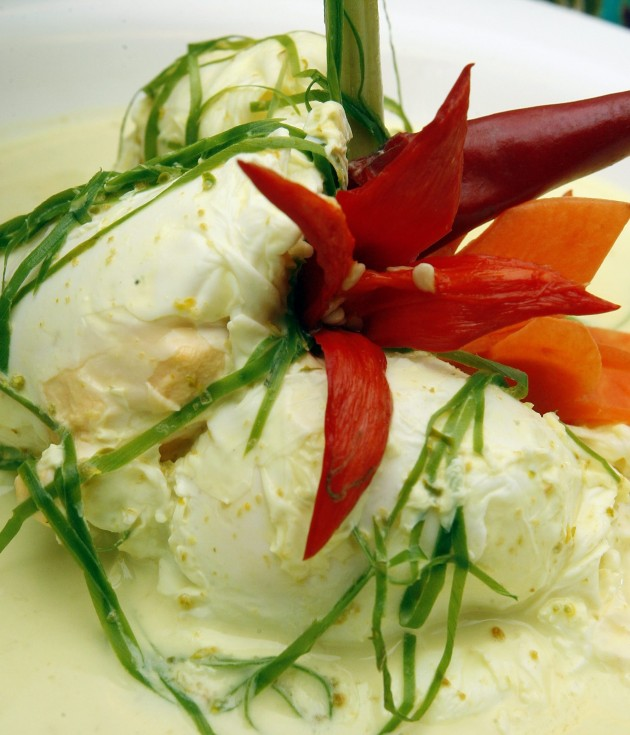 Duck egg cooked in coconut milk and chilli is a popular Minang dish.