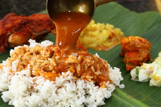 Each banana leaf rice serving at Sri Paandi comes with pappadam, cucumber, brinjal and other vegetables.