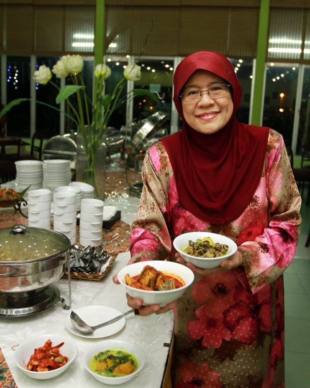 Habsah Hassan, the owner of Puteri Penchala Restaurant, showing off the two Malay dishes available at the outlet.