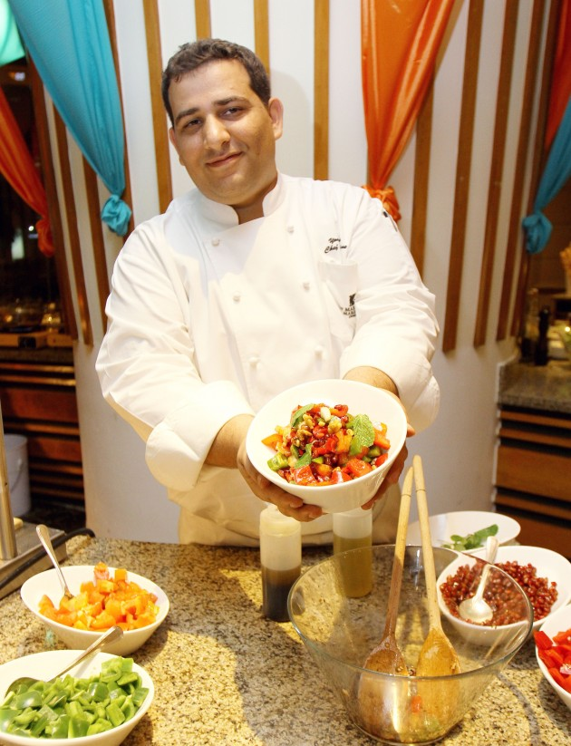 Chef Youssef Issa with the Pomegranate Walnut Salad.