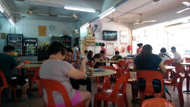 Customers having breakfast at the coffee shop.
