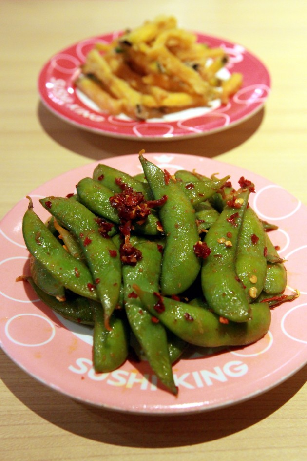 For starters, try the Spicy Edamame (front) and the Pumpkin Tempura.