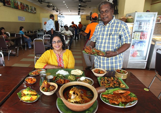 Pushparani (left) and Kuna showing some of the restaurant's best dishes