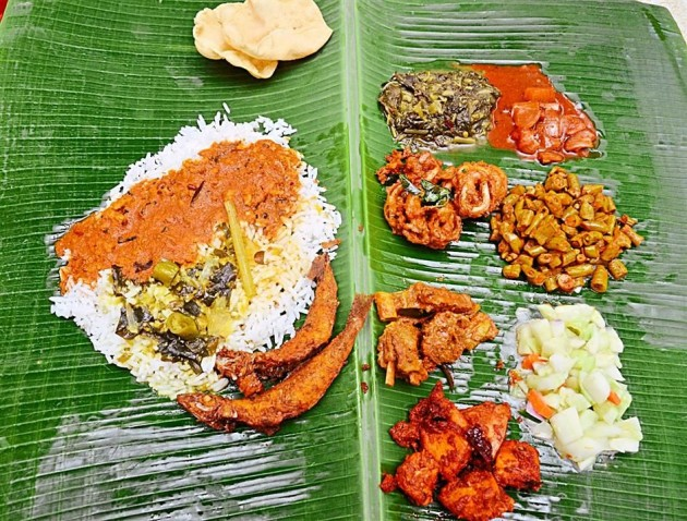 Rice is served with a variety of vegetable dishes and papadam on the side at Sri Ganapathi Mess in Old Town, Petaling Jaya.