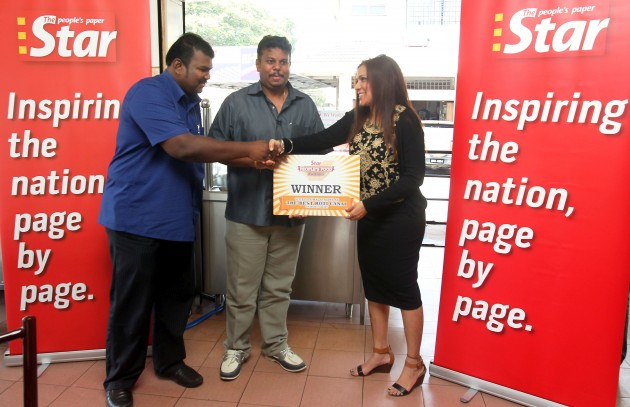 Esther (right) presenting a mock recognition certificate to Yoges (left) and Thelaganathan.