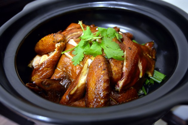 Succulent speciality chicken served in a clay pot.