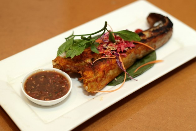 The grilled stingray or Ikan Pari Bakar is best eaten with the tamarind sauce.