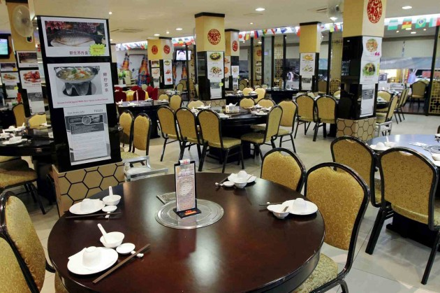 The restaurant features a typical Chinese food establishment decor and feel.