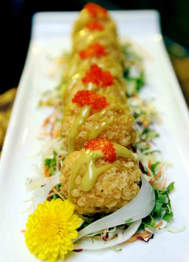 Topped with preserved flying fish roe (tobiko), these Ebi Tango Furai (deep fried prawn meatballs) are a good starter for those dining at Fu-Rin.