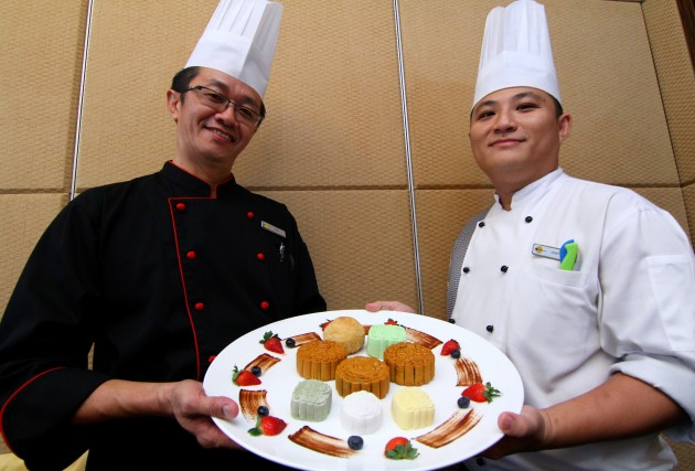 Chan and dim sum chefJordon Chin showing some of the restaurant's specially prepared mooncakes for the Mid-Autumn Festival.