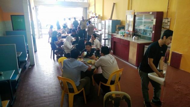 Customers enjoying their lunch at Nasi Lemak Royale.