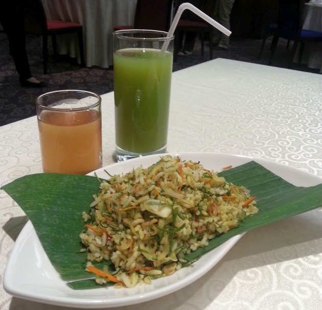(Drinks from left) The refreshing Lemongrass juice and sourish hot plum juice compliments the Nyonya cuisine well. Seen here is also the Nasi Ulam.