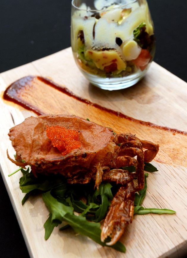 Signature Summer Salad  Soft shell crabs served on a bed of arugula with signature mango summer salad.