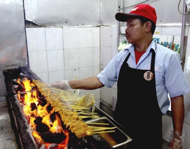 A Sate Kajang Hj Samuri worker at the old Medan Sate shop in Jalan Sulaiman, Kajang, grilling the much-loved satay.