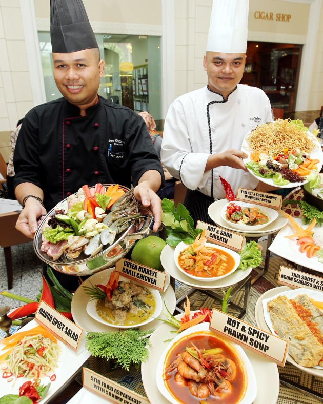 Chefs Ahmad (left) and Shumizan presenting their October specials.
