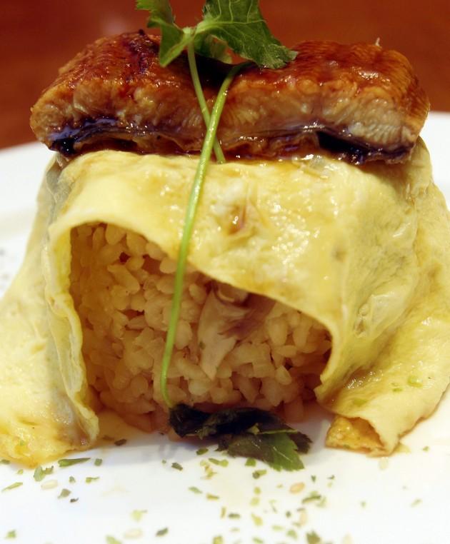 Unagi and mushroom rice wrapped in egg with honey teriyaki glaze.