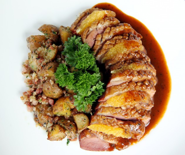 The Balsamic Glazed Smoked Duck  Breast, with potato and pork bacon  on the side.