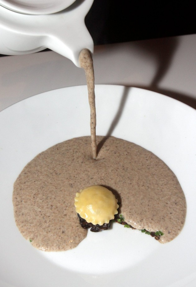 The Creme de Champignons with Smoked Duck Ravioli and Truffle Oil is a thick and savoury delight.