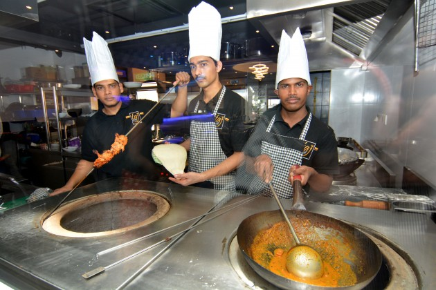 Biryani specialist Chef Rehman Sharieff, Tandoor specialist Chef Pavan Singh and South Indian curry specialist Chef Muthukrishnan in action at Taj Biryani House.