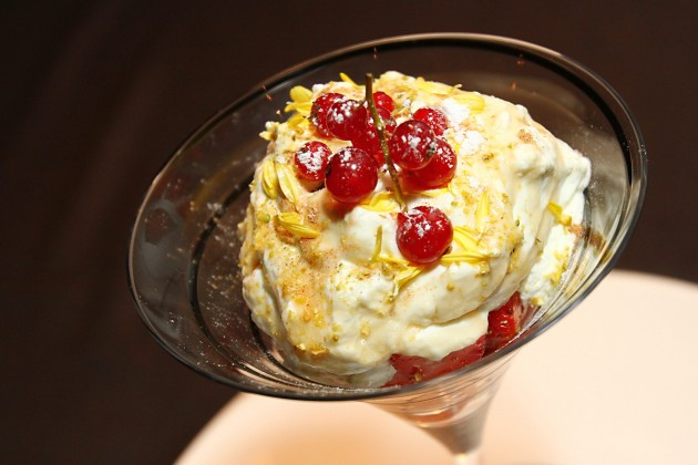 Strawberry Romanoff is made out of whipped cream, fresh strawberries and topped with mashed nuts.