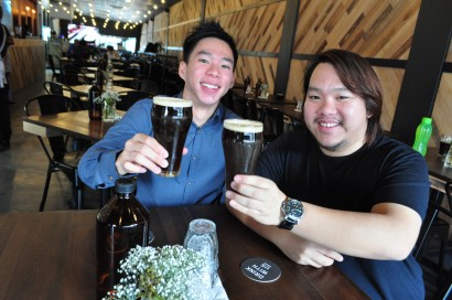Long, cool one: Kar Weng (left) and Kaw Wai started with carbon dioxide gas at first but changed to nitrogen later when they realised that was what Guinness Stout used to get a good head of foam.