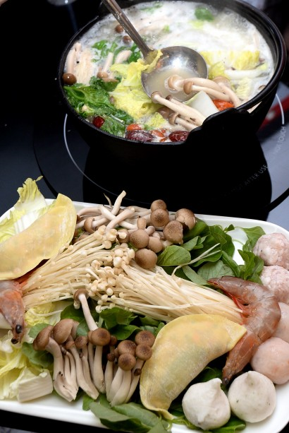Just like any steamboat, you can order straw mushrooms, seafood like fresh prawns, and meat slices.