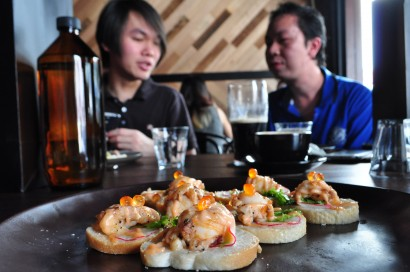 Scrumptious canapes of slipper lobster on french bread, waiting to be washed down by coffee from the tab.